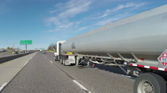 Semi gas tanker passing on highway - stock footage