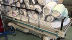 Linens in Hospital - Cleaned and stacked on a bed Stock Footage