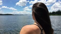 Girl enjoying weekend trip while looking at lake Stock Footage