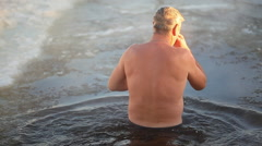 Man Bathe In The Icy Water - stock footage