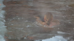 Man Bathing In An Ice-Hole Stock Footage