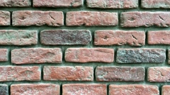 Brick red wall in 4K resolution. Stock Footage