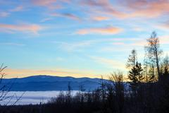 Fantastical sunset scenery over foothills. - stock photo