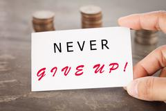 Never give up inspirational quote - stock photo