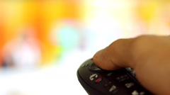 The remote control switches channels on the smart TV Stock Footage