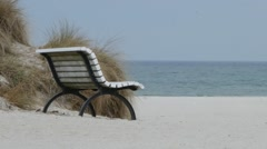 White wooden bench on the beach Stock Footage
