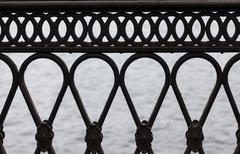Cast iron railing of the bridge closeup Stock Photos