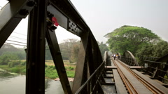 River Kwai world war 2 rail bridge rail track perspective with red poppy on blac Stock Footage