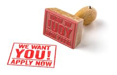 A rubber stamp on a white background - We want you - stock photo
