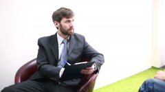 Male psychiatrist with pencil and clipboard Stock Footage