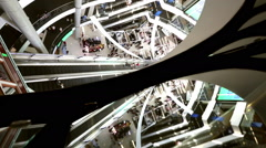 time-lapse shopping center escalators & people rushing in space age cell Stock Footage
