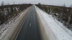 Flying over empty road in the north Stock Footage