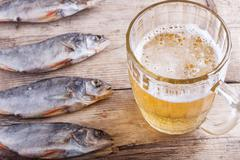 beer and fish closeup - stock photo