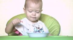 Baby girl eating porridge 4k UHD (3840x2160) Stock Footage