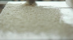 Cleaning sawdust from the workplace of a carpenter - stock footage