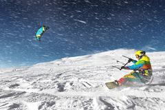 Snowboarder with kite on free ride. Sheregesh resort, Siberia, Russia Stock Photos