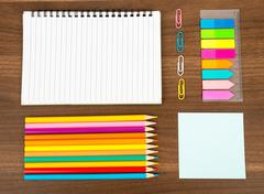 Open notebook with stationary - stock photo