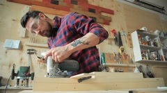Carpenter works with wood-working machine - stock footage