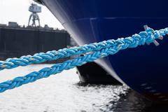 rope anchoring the ship backgriund. mooring end - stock photo