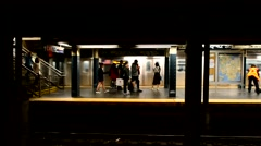 NEW YORK CITY – OCTOBER 2015: Subway train in station. The NYC subway system is Stock Footage