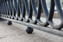 cast iron railing of the bridge closeup - stock photo