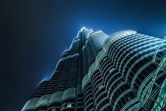 Burj Khalifa vanishing at night sky Stock Photos
