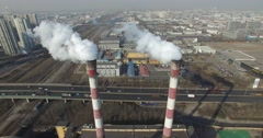 VERTICAL SMOKE STACKS BURNING COAL AT FACTORY IN CHINA - GLOBAL WARMING - stock footage