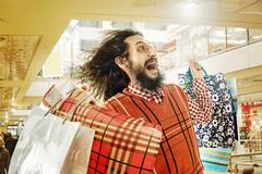 Funny guy on a shopping trip - stock photo