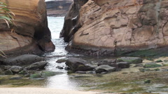 Water and stone transformation shaped rocks at Yeliu (Yehliu) Geopark Taiwan Stock Footage