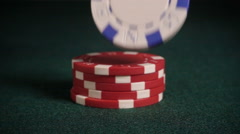 Casino chips falling onto pile, slow motion - stock footage