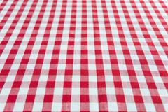 Checked red and white tablecloth - stock photo