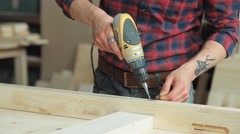 Drill the wood with a screwdriver - stock footage