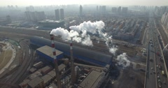 AERIAL FLY AROUND OF AIR POLLUTION - VERTICAL SMOKE STACKS - FACTORY IN CHINA Stock Footage