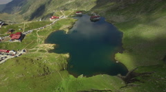 Aerial view over Balea Lake and Mountain. Stock Footage