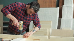 Use a screwdriver in the manufacture of wood products Stock Footage