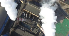 OVERHEAD VIEW OF SMOKE STACKS BURNING COAL AT INDUSTRIAL PLANT IN CHINA - stock footage
