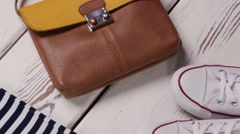 Leather purse and wicker hat. Stock Footage