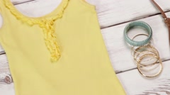 Yellow top and flip-flops. Stock Footage
