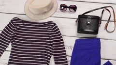 Striped top and blue pants. - stock footage
