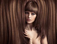 Sensual lady with a fluffy coiffure - stock photo