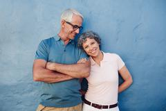 Beautiful mature woman standing with her husband Stock Photos