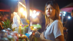Young Woman buying juice in night market 4k UHD (3840x2160) Stock Footage