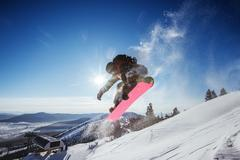 Snowboarder jumps on background of mountains view. Sheregesh resort, Siberia, Stock Photos