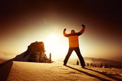 Man stands in winner pose on the top of a mountain. Sheregesh resort, Siberia Stock Photos