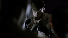 4K Muscular MMA fighters training together in dark environment - stock footage