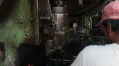 Metalworking Machine Shop - MCU stamping press seen over worker's shoulder Stock Footage