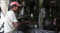Metalworking Machine Shop - MCU worker feeds blanks into metal stamping press - stock footage