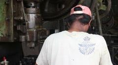 Metalworking Machine Shop - MCU of worker tending a heavy stamping press Stock Footage