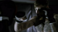 4K Muscular MMA fighters training together in dark environment Stock Footage