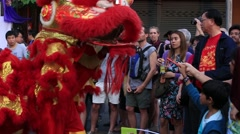 Dragon dance in Chinatown during Chinese New Year in Bangkok, Thailand Stock Footage